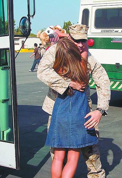 Sgt. Steven Lubich is greeted by his wife, Laura, as he returns to Camp Pendelton after a 10-month deployment to Iraq.