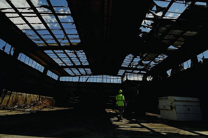 Kevin Clifford/Nevada AppealKland Moore, worker for Waste Management, walks through an empty Sutro Transfer Station Tuesday afternoon after a fire damaged the facility Monday afternoon.