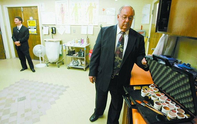 BRAD HORN/Nevada Appeal Lewis Noel closes a cosmetic case in the preparation room at Walton's Chapel of the Valley.
