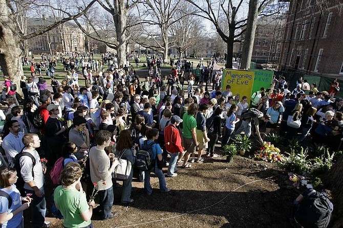 AP Photo/Gerry BroomeStudents gather on campus during a memorial for University of North Carolina student body president Eve Carson in Chapel Hill, N.C., Thursday. Carson was found dead Wednesday morning around 5 a.m.