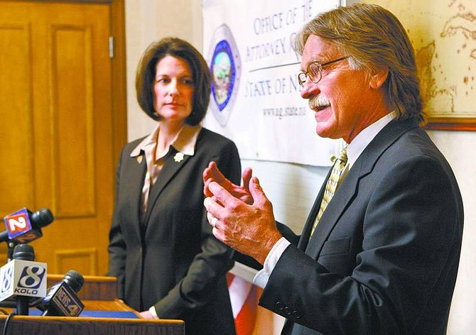 State Nuclear Projects chief Bob Loux and Attorney General Catherine Cortez Masto answer questions from the media Wednesday about the fight against the Yucca Mountain repository on Wednesday.  Cathleen Allison/ Nevada Appeal