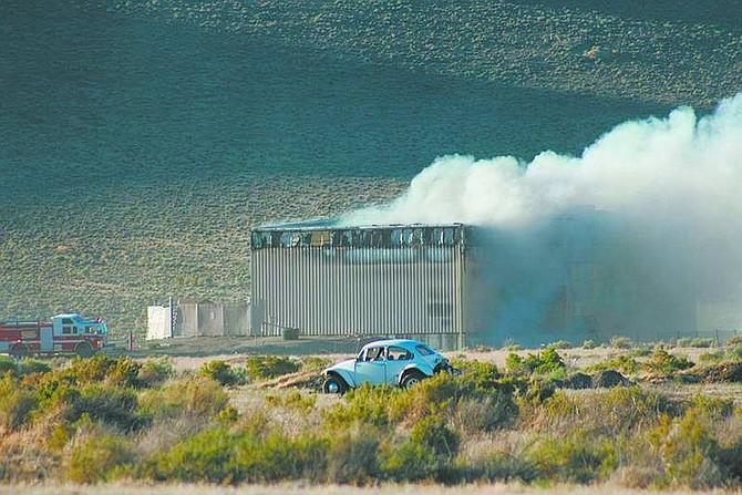 Rhonda Costa-Landers/Nevada AppealA fire burns at the Sutro Transfer Station in Dayton Monday evening.