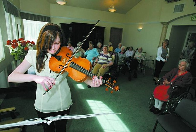 """BRAD HORN/Nevada AppealAshley Gerber, 16, plays """"Love at Home"""" on the viola at Sierra Place Retirement Community for the residents on Wednesday."""