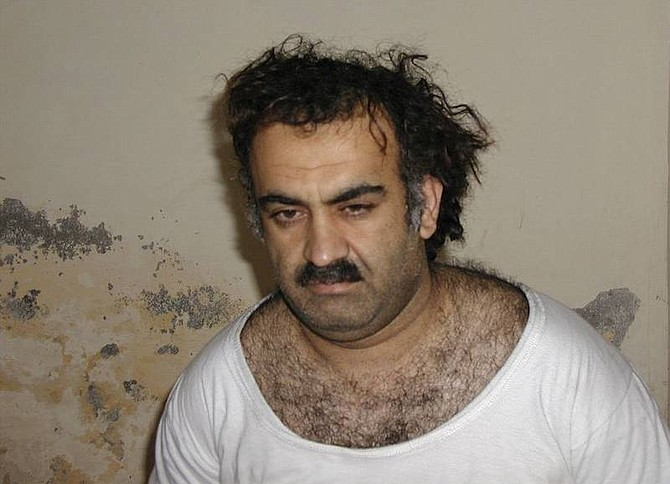 AP Photo-FileKhalid Sheikh Mohammed, the alleged Sept. 11 mastermind, is seen shortly after his capture during a raid in Pakistan in this file photo from March 1, 2003 in this file photo obtained by the Associated Press. Mohammed, who could face the death penalty for his role in the Sept. 11 attacks, has been peppering his military lawyer with questions in advance of his war crimes trial at Guantanamo, the attorney tells The Associated Press.