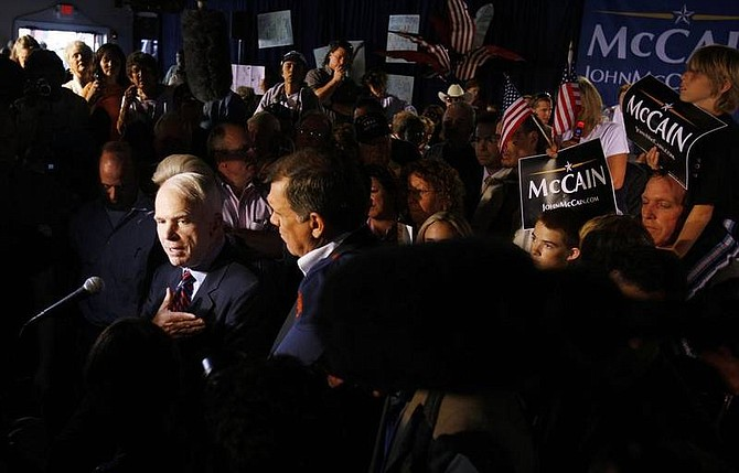 AP Photo/Charles DharapakResidents and supporters gather around as Republican presidential hopeful Sen. John McCain, R-Ariz., left, takes questions from reporters after a campaign event at the Shell Factory and Nature Park in North Fort Myers, Fla., Saturday, Jan. 26, 2008.