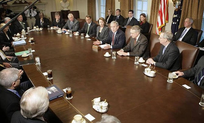 Pablo Martinex Monsivais/AP photoPresident Bush, center right, meets with Congressional leaders to discuss the economy in the Cabinet Room of the White House in Washington.