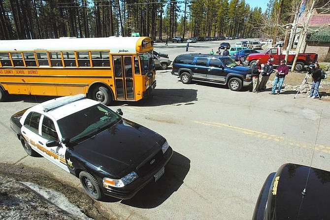 A Douglas County School District bus heads to Zephyr Cove Elementary School to pick-up students Thursday after ZCES and George Whittell High were on lockdown after a person was allegedly spotted in the woods near the schools.  Photos by Dan Thrift / Nevada Appeal News Service