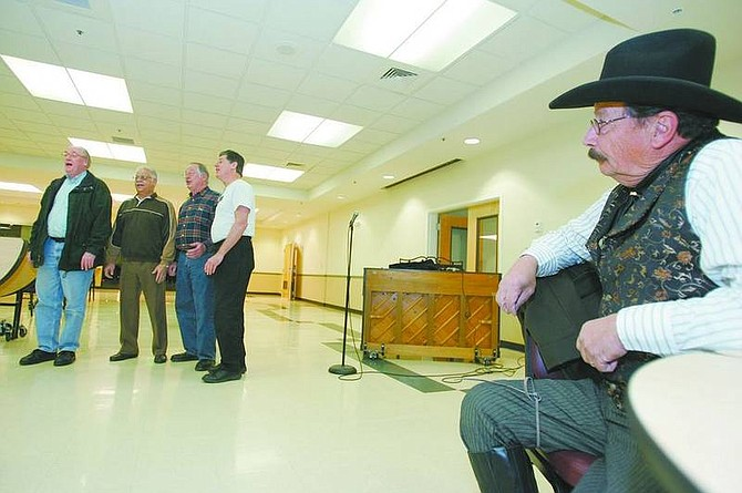 BRAD HORN/Nevada Appeal Cliff Ott, of Dayton, watches auditions for the upcoming Senior Follies at the Carson City Senior Citizens Center. Ott is performing cowboy poetry for the show.