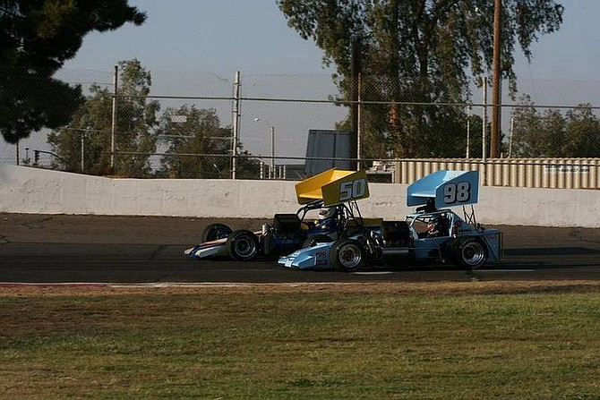 Rhonda Costa-Landers/Nevada AppealTroy Regier, in the No. 98 S&S Motorsports supermodified racecar of Carson City, passes Whitey Janssen of Dayton during the second heat race at Madera Speedway in Madera, Calif. Saturday. Regier finished third in the heat race; Janssen finished fourth.