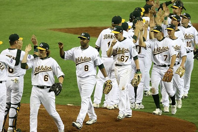 AP Photo/David GuttenfelderOakland Athletics celebrate as they leave the field after beating the Boston Red Sox 5-1 in their Major League Baseball regular season game at Tokyo Dome in Tokyo, Wednesday, March 26, 2008.