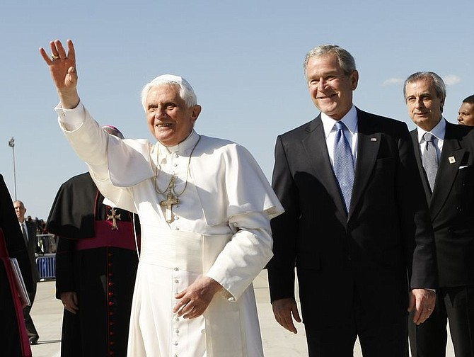 President Bush escorts Pope Benedict XVI upon his arrival at Andrews Air Force Base in Maryland, Tuesday, April 15, 2008. (AP Photo/Gerald Herbert)