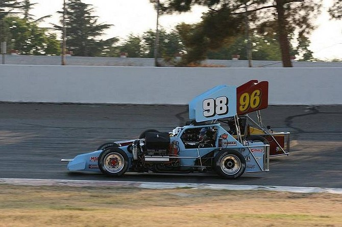 Rhonda Costa-Landers/Nevada AppealTroy Regier (98) makes an inside pass on Kenny White (96) for the lead and win in the first heat race of the Supermodifed Racing Association at Madera Speedway in Madera, Calif. Saturday.