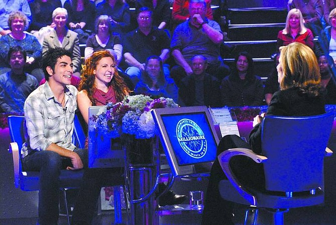 """Photo courtesy of Valleycrest Productions Ltd. Engaged couple Nick Aliberti, left, and Sierra Scott, center, are shown during a taping of """"Wedding Week"""" on Who Wants to be a Millionaire. Scott, from Carson City, and Aliberti will be on Monday and Tuesday's shows, airing at 7 p.m. on ABC."""