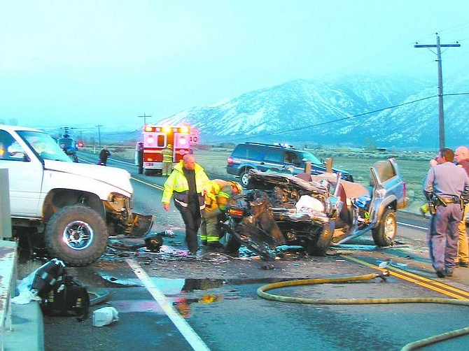 KurT Hildebrand/Nevada Appeal NEws Service Emergency personnel work at an accident scene on Highway 88 south of Mackland Avenue in Douglas County.