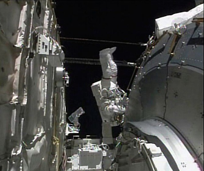 In this image from NASA TV astronaut Ron Garan is seen during a space walk in the payload bay of the shuttle Discovery while he is preping the Kibo lab for installation, Tuesday, June 3,2008.  (AP Photo/NASA TV)