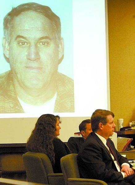 Shannon Litz/Nevada Appeal News ServiceRobin Bodden's picture is displayed on the overhead screen while Karen Bodden and attorneys Erik Johnson and James Wilson Jr. listen to District Attorney Mark Jackson's closing statements in Judge Dave Gamble's courtroom before jury deliberations on Tuesday.