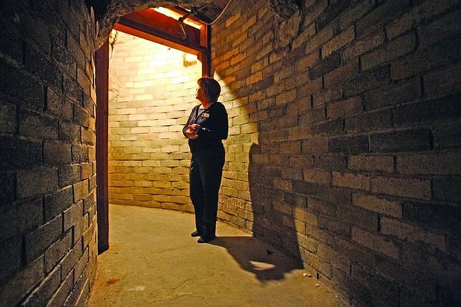 Jen Schmidt/Nevada Appeal News ServiceCal Neva employee Debbie Oliphant stands, looking up the stairs that lead to Frank Sinatra's cabin in the infamous paparazzi-proof tunnel that connected to various spots inside the hotel, including the Indian Room and the Showroom.