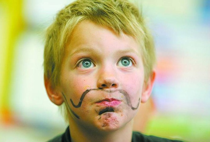 BRAD HORN/Nevada Appeal Grant Blattman, 7, works on a project in his classroom at Dayton Elementary School Wednesday.
