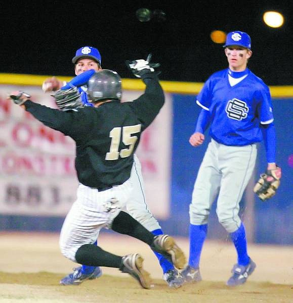BRAD HORN/Nevada Appeal Carson's Markus Adams turns a double play against Galena at Ron McNutt Field on Saturday.