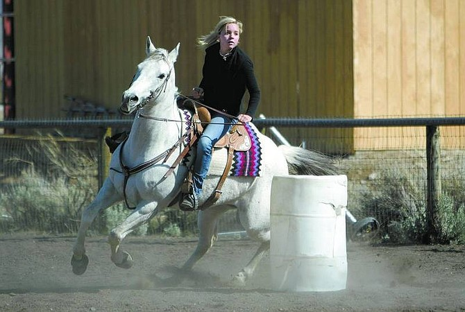Amy Lisenbe/Nevada AppealElyse Heberger, 17, practices barrel racing with her horse Ruby at her home in Washoe Valley Monday.