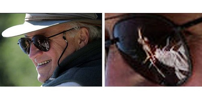 AP Photo/White House, David BohrerThis two-picture combination photo provided by the White House shows Vice President Cheney, and a close-up of his sunglasses during a fishing trip on the Snake River in Idaho. That is not a naked woman reflected in Vice President Dick Cheney's sunglasses. Although it kind of appears to be. It you blow up the picture, you can see it is Cheney's hand gripping the handle of a fishing rod. The picture was posted on the White House Web site as one in a series of photos of Cheney outdoors. It created a buzz on the Internet on Friday and some cable television shows.