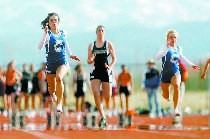 BRAD HORN/Nevada Appeal Carson's Kayla Sanchez, left, won her heat of the 100 meter dash while Julianne King, right, finished second on Wednesday at Douglas High School in Minden.