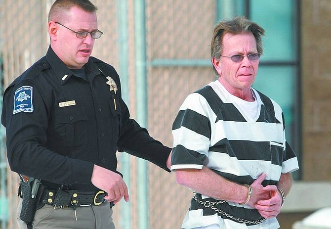 Cathleen Allison/Nevada AppealStorey County Sheriff's Lt. Chris Parsons escorts William Beeson to court Wednesday in Virginia City. Beeson, a former English and theater arts teacher at Virginia City High School, appeared on sexual assault charges.