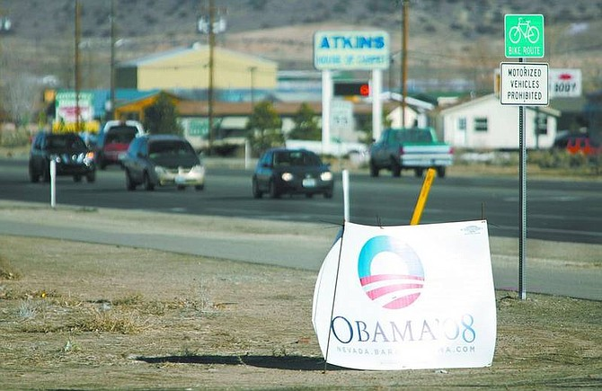 Cathleen Allison/Nevada Appeal Campaign signs are beginning to appear around town. Local ordinance prohibit signs from being affixed to trees, shrubs, traffic control signs or support structures, utility poles, or any structure within the public right of way.