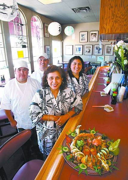 Cathleen Allison/Nevada Appeal Gina Chaikwang, center, owner of Thai Spice Kitchen, has recently opened the new sushi bar section of the downtown restaurant. Also seen are, from left, Ruben Vargas, Julio Lopez and Magaly Trujillo.