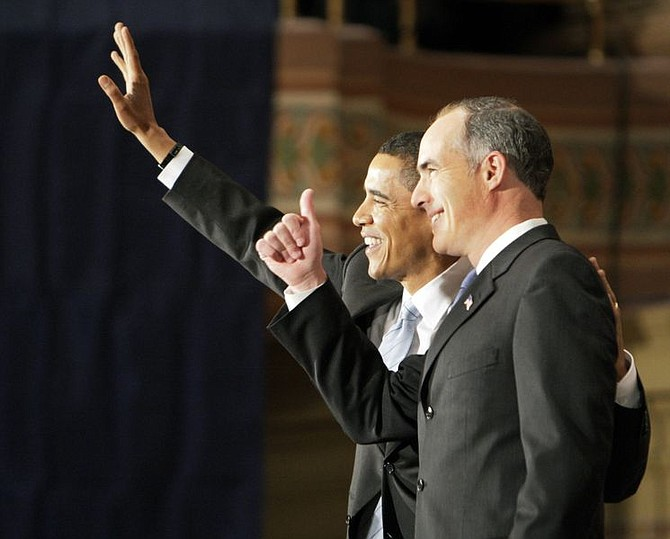 Democratic presidential hopeful Sen. Barack Obama D-Ill., left, accompanied by Sen. Bob Casey Jr., D-Pa., waves at the Soldiers and Sailors Museum and Memorial in Pittsburgh, Pa., Friday, March 28, 2008 where Casey announced his endorsement of Obama.(AP Photo/Alex Brandon)
