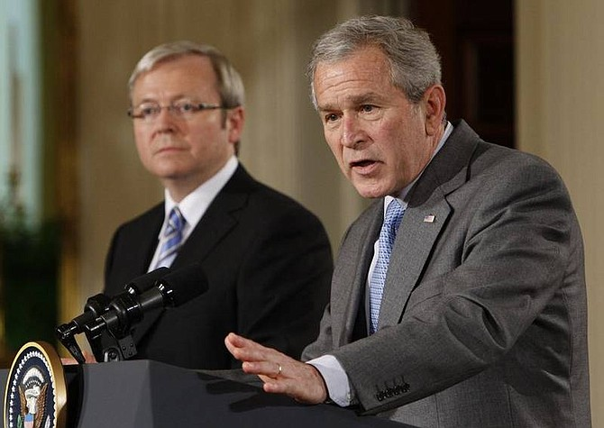 AP Photo/Ron EdmondsPresident Bush and Australian Prime Minister Kevin Rudd hold a joint news conference Friday in the East Room at the White House. Rudd took over in November on a pledge to pull Australia's 500 combat troops out of Iraq as soon as possible.