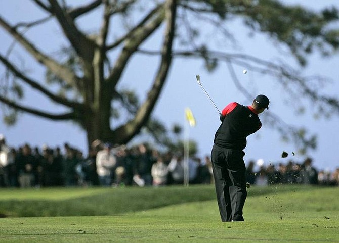 Lenny Ignelzi/Associated Press Tiger Woods hits his second shot on the first hole of South Course at Torrey Pines during the final round of the Buick Invitational golf tournament Sunday, in San Diego. Woods birdied the hole.   Asscoa