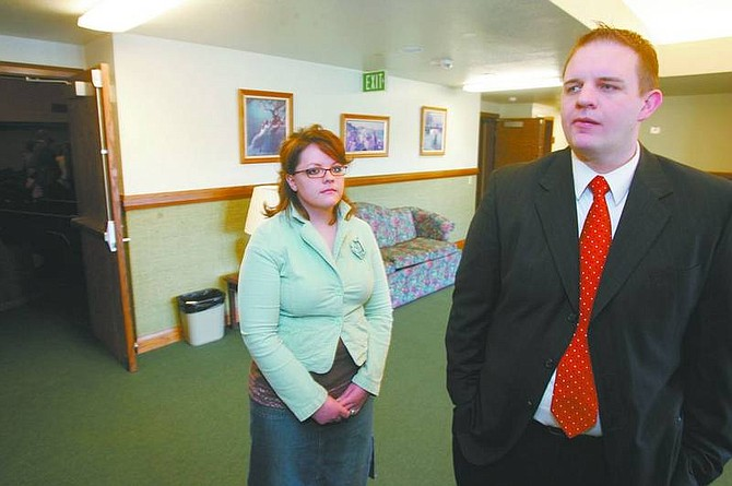 BRAD HORN/Nevada Appeal Mike Fontano and Liana Starks discuss the influence the Church of Jesus Christ of Latter-day Saints' late president Gordon B. Hinckley had on their lives before watching his funeral service on television at the Carson City stakecenter on Saturday.
