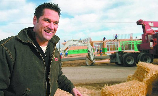 "Amy Lisenbe/Nevada Appeal Johnny Littlefield, a designer on the TV series, ""Extreme Makeover: Home Edition,"" smiles as he fields questions in Stagecoach on Apache Drive Tuesday afternoon. Progress on the Boettcher's new home is evident in the background."