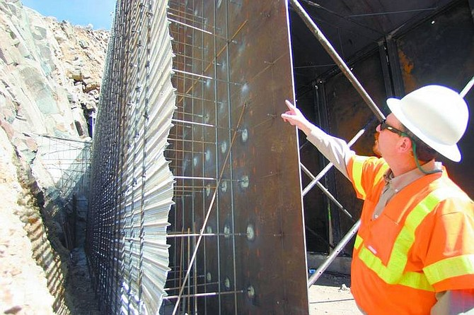 Amy Lisenbe/Nevada Appeal Gary Luce, senior engineer and geologist at Geocon Consultants, Inc., explains part of the inspection process for the frame work on Tunnel Two of the V&T Railway Monday afternoon.