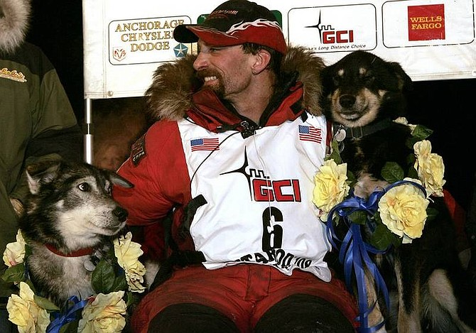 AP Photo/Al GrilloLance Mackey sits with two of his dogs,  Larry, left, and  Handsome after winning the Iditarod Trail Sled Dog Race in Nome, Alaska early Wednesday March 12, 2008.