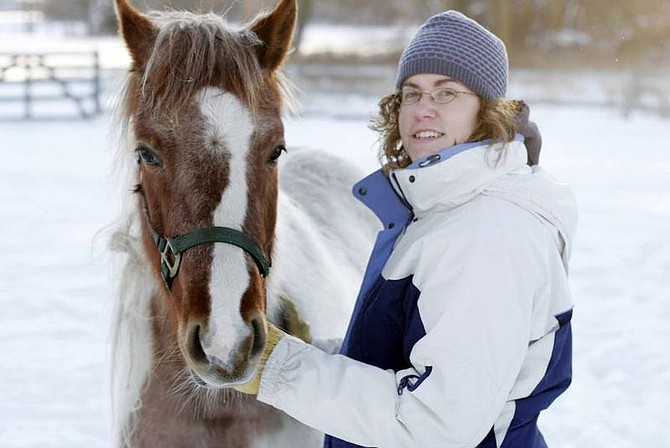 """AP Photo/The Saginaw News, Dana RieberKristen DeGroat, 25, of Akron, Mich., shown on Tuesday, bought a classified ad to sell her horse, Foxy, a 3-year-old mare. Because of a goof at the newspaper, a classified ad for her horse ran under the header """"Good Things to Eat"""" instead of the one for horses and stables. DeGroat has fielded dozens of calls over the past two days from unhappy animal lovers."""