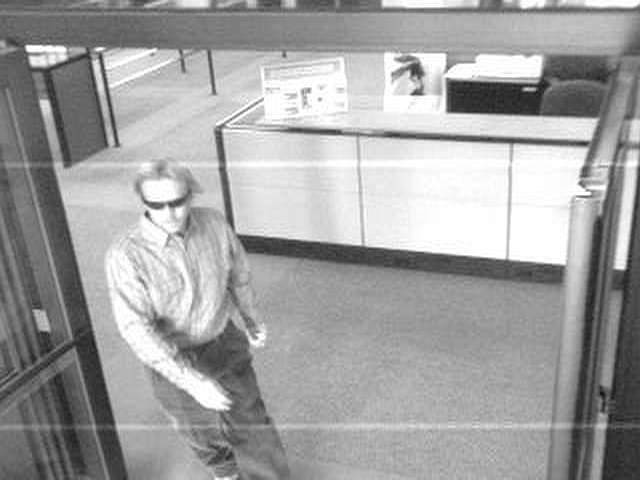 Surveillance photograph of a man who robbed a Reno bank this afternoon.