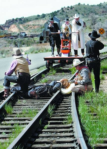 File Photo/Nevada Appeal Members of The Comstock Living Legends re-enacted a shootout scenario with good guys and bad guys and a damsel in distress, tied to the train tracks last year. The re-enactment was created for the Nevada Passage Handcar Races held on the V&T tracks in Virginia City.