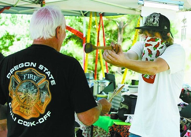 BRAD HORN/Nevada Appeal Jason Beaver, of Sonora, Calif., holds up Harry Robinson for his chili at the High Sierra Regional chili cook-off at Glen Eagles Restaurant on Saturday.