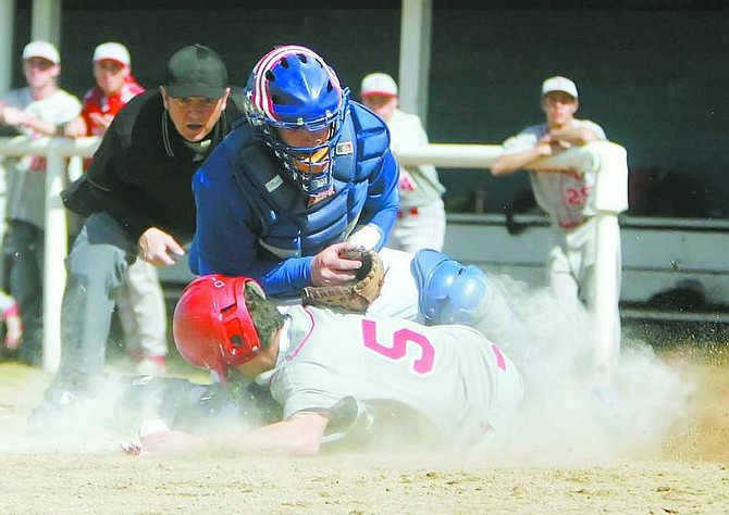 BRAD HORN/Nevada Appeal Carson catcher Cody Bone tags a Truckee runner out at the plate during their game at Ron McNutt Field on Thursday.