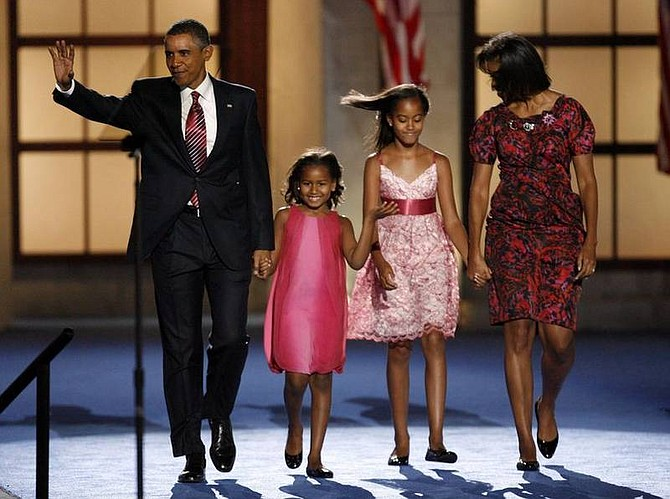 AP Photo/The Dallas Morning News, Vernon BryantDemocratic presidential nominee Barack Obama takes the stage with his wife Michelle and their children Malia, second from right, and Sasha, second from left, Thursday, Aug. 28, 2008 at Invesco Field at Mile High in Denver, on the final day of the Democratic National Convention. Obama formally accepted the party nomination for president, and will face Republican presidential candidate John McCain in the fall.
