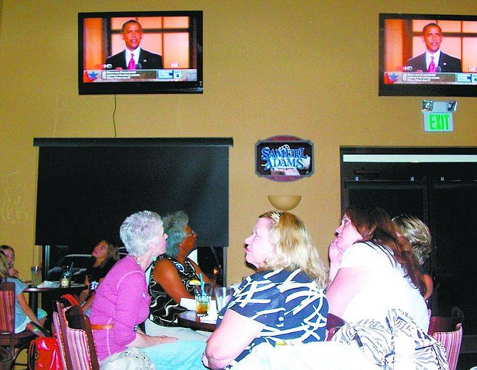 Karen Woodmansee/Nevada AppealFrom left, Johnye Saylor and Thelma Bataille watch Sen. Barack Obama on one TV screen at the First and 10 Bar and Grill in Dayton on Thursday night while Brenda Ritter, Sherri Marsh and Dorothy Wingard watch another screen.