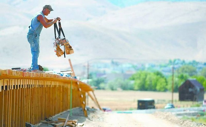 Cathleen Allison/Nevada AppealChuck Harris, with Road and Highway Builders, packs up his tools Friday afternoon on the Fifth Street bridge area of the Carson Bypass.