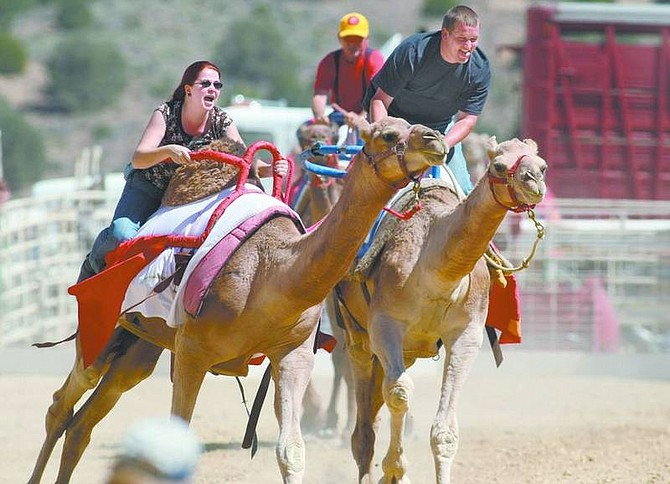 Cathleen Allison/Nevada AppealWhitney Shannon and Matt Rogers race in the Virginia City International Camel Races on Friday afternoon. The camel races continue today and Sunday.