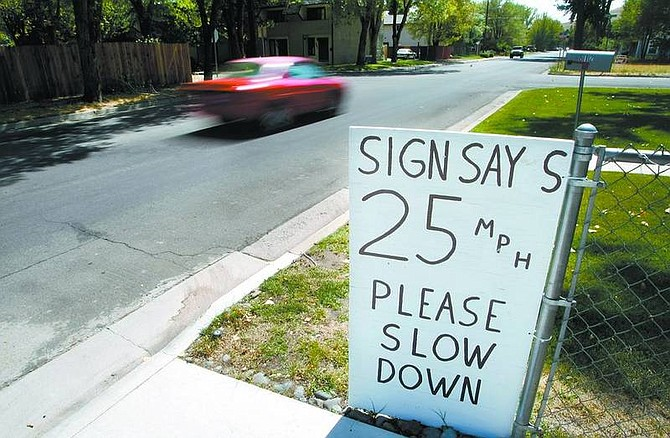 Cathleen Allison/Nevada AppealResidents on Division at Seventh streets have posted a homemade sign to encourage passing motorists to slow down.
