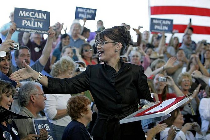 (AP Photo/Eric Risberg)Republican vice presidential candidate, Alaska Gov. Sarah Palin, reaches to shake hands at a campaign rally in Carson City, Nev., Saturday, Sept. 13, 2008.