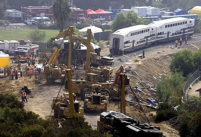 AP Photo/ Hector MataFirefighters continue to work on the wreckage of a Metrolink commuter train, Saturday, Sept. 13, 2008 in Chatsworth, Calif. Emergency crews found more victims early Saturday in the mangled wreckage of a commuter train that smashed head-on into a freight train, raising the death toll to 24 in the deadliest U.S. passenger train accident in 15 years.