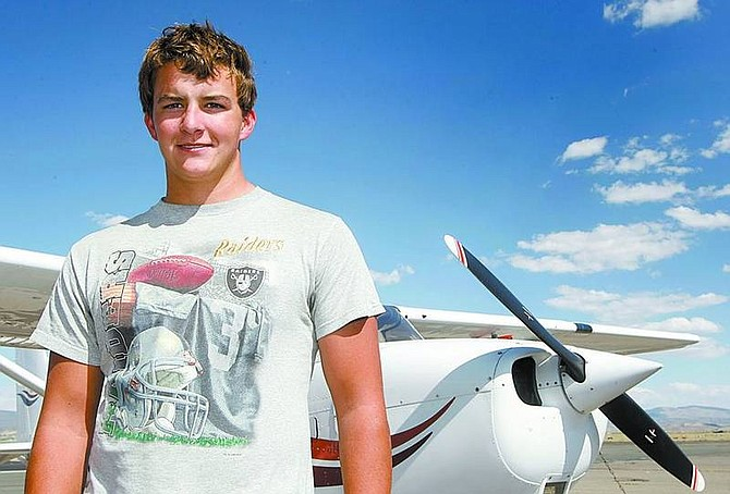 Shannon Litz/Nevada Appeal News ServiceSixteen-year-old John Patchell and the Cessna 172SP he flew on Sept. 7 at the Minden-Tahoe Airport.