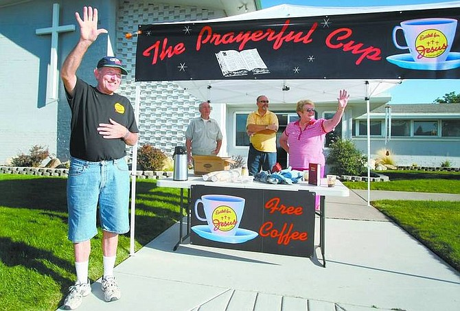 Cathleen Allison/Nevada AppealPastor Brett Metcalf waves to passing drivers in front of the Excited for Jesus church on Clear Creek Road on Tuesday morning. The church offers a free cup of coffee and prayers to anyone who stops. Volunteers, from left rear, are Tom Been, Larry Brewer and Sharron Brewer.